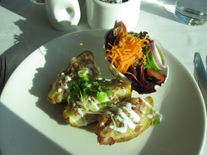 Potato Skins Filled With Cheese, Bacon and toppedwith Sour Cream and Spring Onion