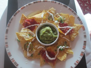 Nachos Served With Salsa, Guacamole, Sour Cream and Jalapenos