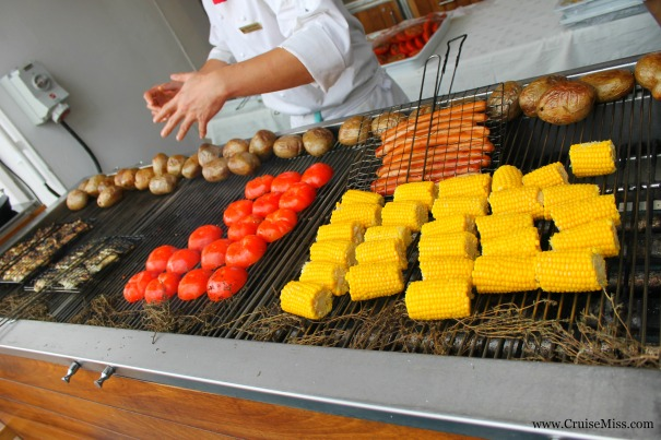 Some of the food from the German themed BBQ - corn on the cob, fresh fish, frankfurters, grilled tomato and jacket potatoes