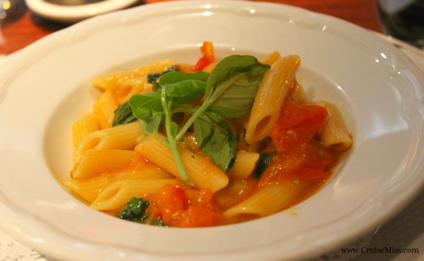 Penne pasta with cherry tomato, garlic and basil sauce